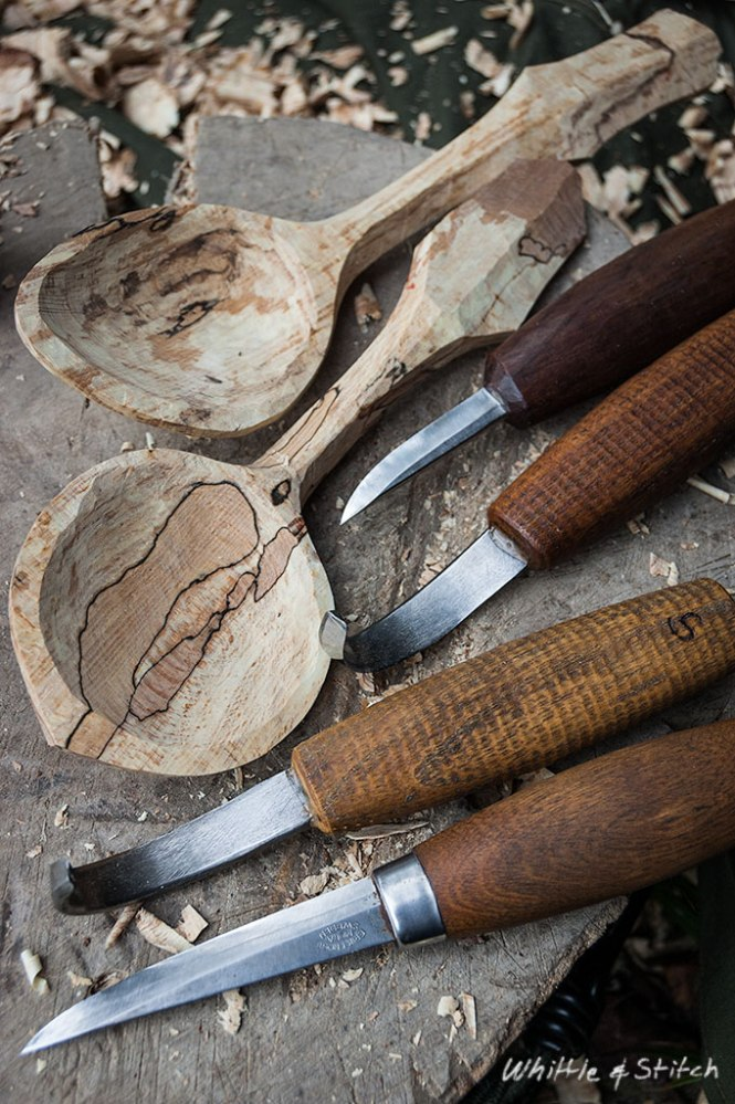 Spoon carving knives and hand carved spoon s in spalted Beech sitting on wooden block. Colour Portrait. © P. Maton 2015 whittleandstitch.net